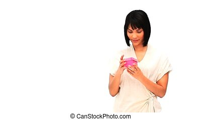 Cute asian woman opening a gift isolated on a white...