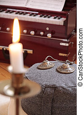 Candle, harmonium and cymbal as decoration in a yoga room