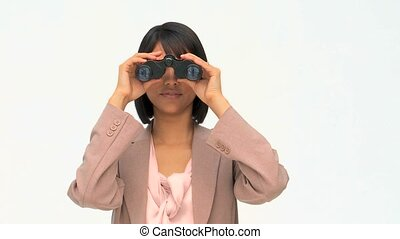 Asian business woman using binoculars isolated on a white...