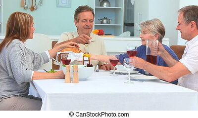 A dinner between elderly friends in the dinning room