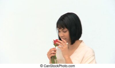 A cute chinese woman holding a flower isolated on a white...