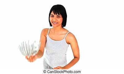 Asian woman kissing her dollars isolated on a white...