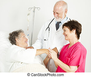 Caring Hospital Staff - Caring doctor and nurse greeting...