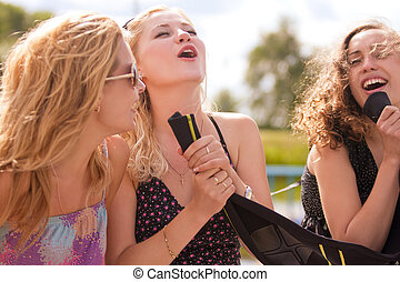 let me sing, sing, sing! - three happy young caucasian...