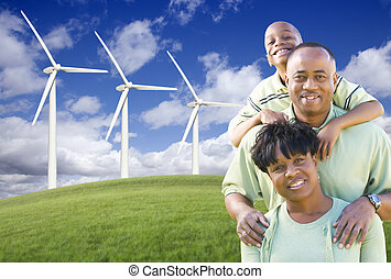 Happy African American Family and Wind Turbine with Dramatic...