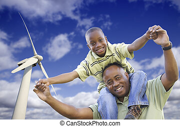 Happy African American Father and Son with Wind Turbine Over...