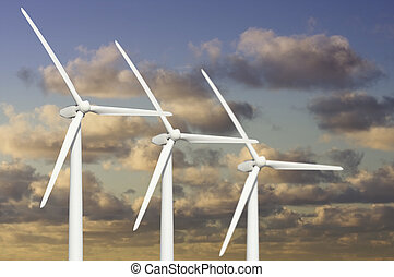 Three Wind Turbines Over Dramatic Blue Sky and Clouds.