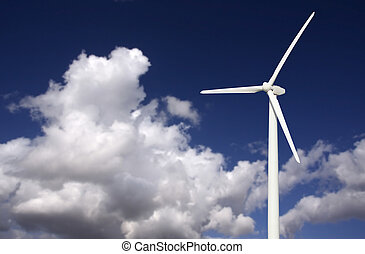 Wind Turbine Over Dramatic Sky and Clouds