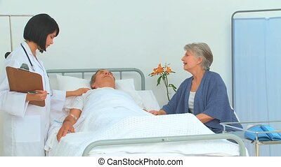 Cute asian nurse listening to heartbeat