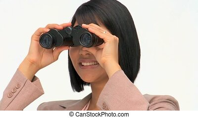 A cute business woman looking at someone through binoculars