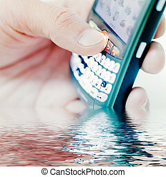 cell phone - hand holding pda cell phone, concept of...