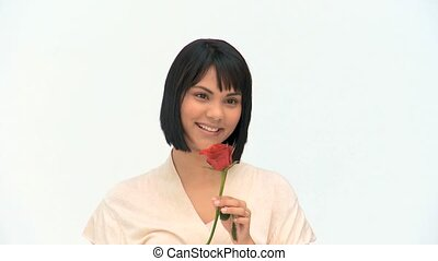 Asian woman holding a red rose against a white background