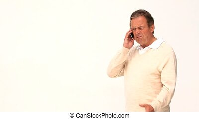Casual man getting very nervous on the phone