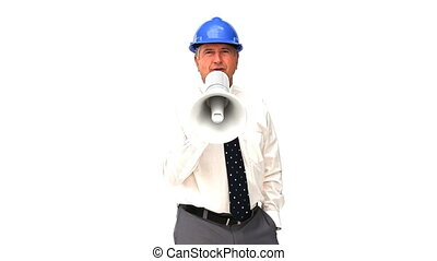 An mature architect shouting through a loudspeaker against a...