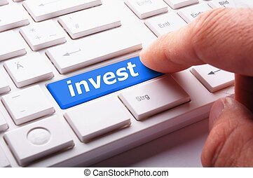 investment - invest key on keyboard showing financial...