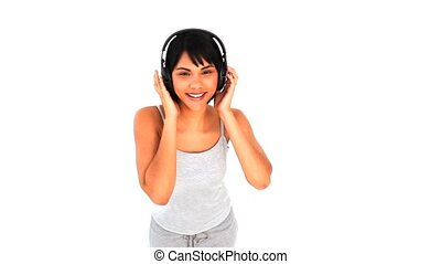 Lovely asian lady with headphones isolated on a white...