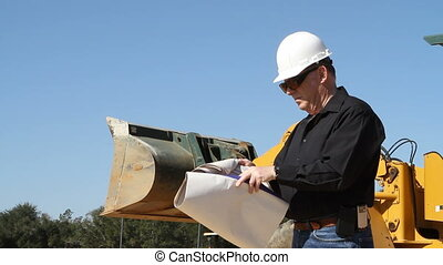 Building Inspector - Building inspector in hardhat looks at...