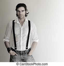 Man in suspenders - Portrait of an attractive relaxed male...