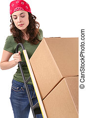 Woman with Moving Boxes - A pretty woman moving and shipping...