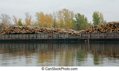 ship loaded with wood on the river