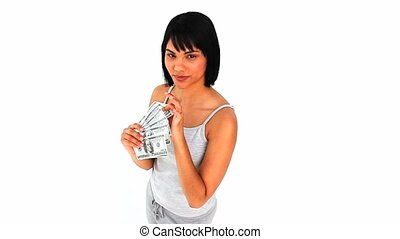 Asian woman showing off her money against a white background