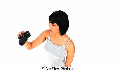 Casual asian woman with binoculars isolated on a white...