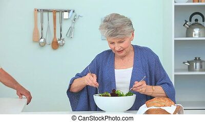 A woman preparing a salad