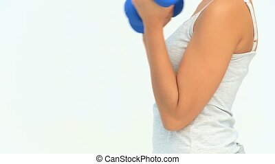 Asian woman doing exercise with dumbbells isolated on a...
