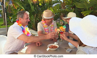 Mature friends celebrating