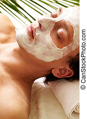 Clearing mask - Young man having pore cleaning procedure in...