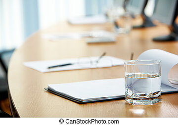 During conference - Image of workplace with paper, glass of...