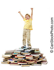 Lucky schoolkid - Portrait of cute kid standing on pile of...