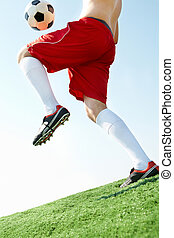Hitting the ball - Horizontal image of soccer ball being...