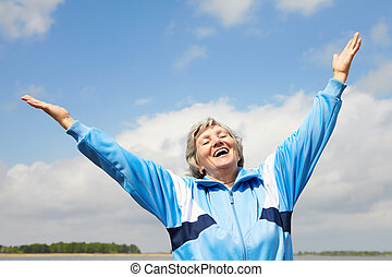 Excited female - Portrait of mature woman with her arms...