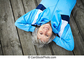 Serenity - Happy mature woman having rest outside