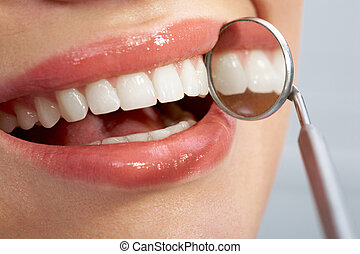 Nice teeth - Close-up of patients healthy smile with mirror...