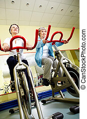 Sport practice - Portrait of senior females doing physical...
