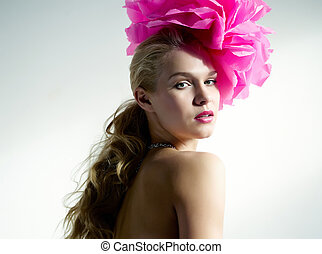 Floral style - Gorgeous woman with pink flower on head...