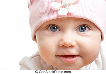Infant - Face of adorable baby in hat looking at camera