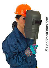 Welder woman holding welding mask isolated on white...
