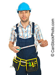Mid adult repairman holding ruler