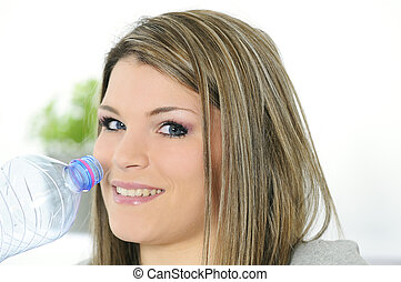 young beautiful woman with a bottle of water