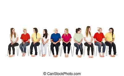 Group of women on chairs in a line - Group of Young women...