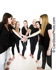 Clasped Hands - Team of Smiling Girls with clasped hands