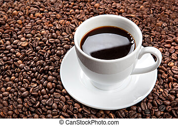 white cup with coffee beans  - white cup with coffee beans
