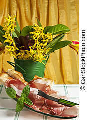 speck - Typical Italian sausage sliced cake and flowers
