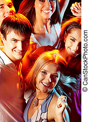 Smart clubbers - Image of attractive young people having fun...