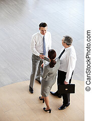 Handshaking partners - Image of business partners...