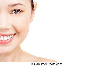 Half of face - Face of Asian female smiling on white...