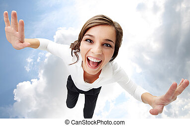 Flying in heaven - High angle view of a girl screaming with...